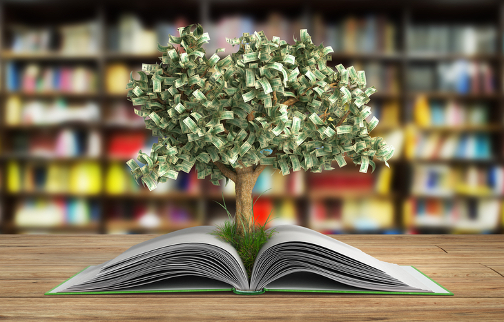 Money Tree Growing Out of Stock Market Book