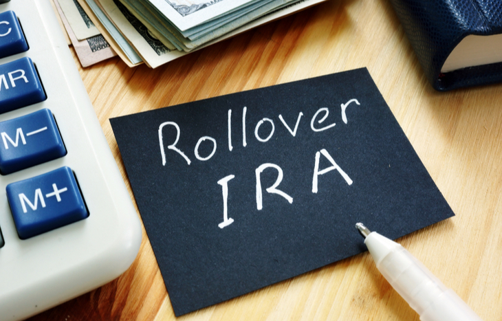 IRA rollover written down next to money and calculator