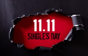 A foreground wall is torn open revealing the caption 11.11 Singles Day.