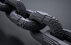 A literal chain made out of blocks representing the idea of blockchain stocks