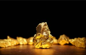 A shiny gold nugget. Are you interested in learning how to invest in gold?