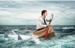 A business man row on a box being chased by sharks in the ocean. Can he make money during a crisis? Yes!