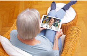 A woman consults with her doctor using telemedicine. Telehealth stocks are a strong bet to do well amid coronavirus.