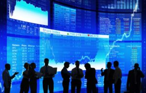 Some traders stand in front of screens on the stock market. But what is the stock market?