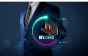 "High dividend stocks can be a great play in a down market. Here a man in a business suit touches a screen that says ""dividend."""