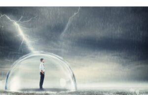 A man in a protective bubble protected from a storm representing the safety of recession proof stocks.