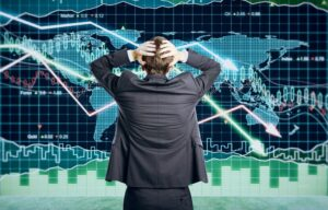 A stock market trader holds his head in despair during a stock market crash