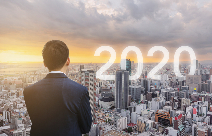 man looking over a city thinking about the best stocks to by in 2020