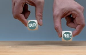 Cheap tech stocks means you are getting good value for the price. Two hands hold dice that say quality and price.