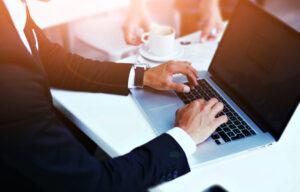 A businessman blogging on a financial site like Investor Junkie.