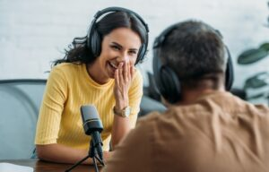 Recording a podcast like this man and woman are here can be a great passive income idea.