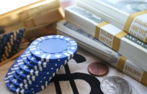A stack of poker blue chips and money. The benefits of blue chip stocks are many.