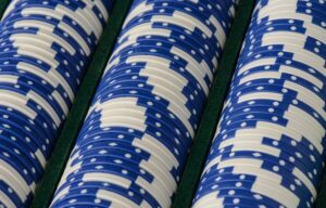 Rows of poker blue chips. High dividend blue chip stocks can be a great investment.