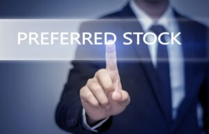 "A businessman touches a screen that says ""preferred stock"""