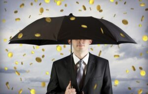 Gold coins rain down on a business holding an umbrella. It must be earnings season!