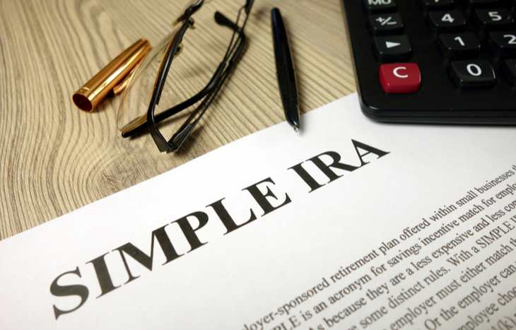 The definition of a SIMPLE IRA plan sitting on a desk