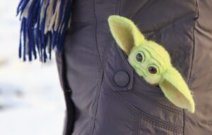 A baby yoda toy indicates the current success of the Disney+ streaming platform.