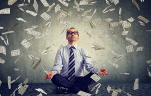 A business person meditating and trying to improve his financial mindset