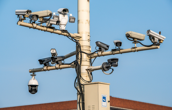A pole of CCTVs in Beijing pointing every direction
