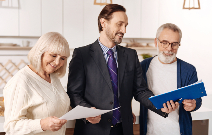 A man discussing early retirement considerations with his clients