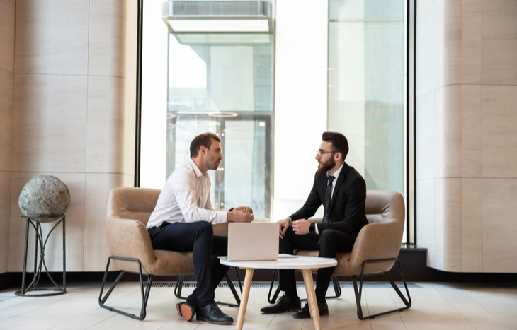 A discount broker talking to a client