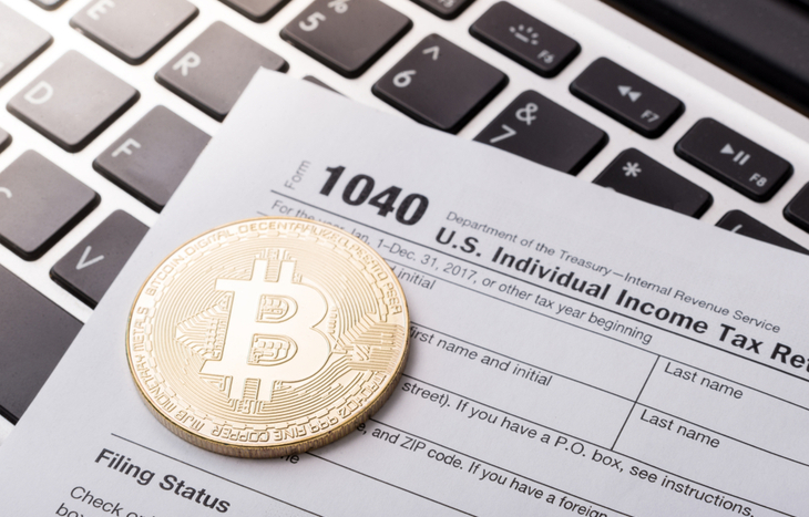 Bitcoin sitting amongst crypto tax forms
